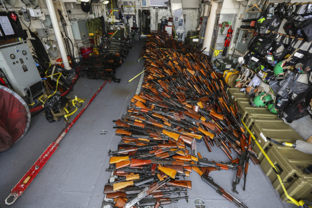 Weapons seized by HMAS Darwin from a small-arms smuggler boarded approximately 170 nautical miles off the coast of Oman. *** Local Caption *** HMAS Darwin  is conducting Maritime Security Operations under the authority of Combined Task Force (CTF) 150 in the Indian Ocean and Arabian Gulf during her deployment in the Middle East Region. HMAS Darwin is deployed on Operation MANITOU, Australia's contribution to the Combined Maritime Forces (CMF).   CMF undertakes patrols to combat piracy and to intercept the trafficking of drugs and weapons that help fund international terrorism. CMF also encourages regional cooperation to create a safer maritime environment.  HMAS Darwin is on her 7th deployment to the Middle East Region and is the 62nd rotation of a RAN vessel in the region since the first Gulf War in 1991.